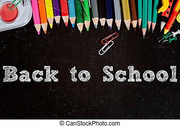 Blackboard with school accessories