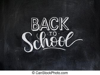 Back to school chalk doodle background on blackboard