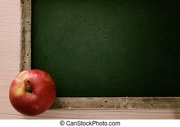 Back to school concept. Apple and chalkboard. Copy space