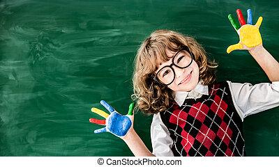 Back to school concept - School child in class. Happy kid...