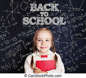 Back to school concept with happy child with school book