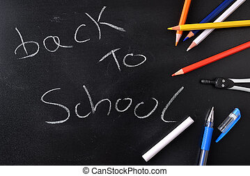 Back to school concept written on a blackboard