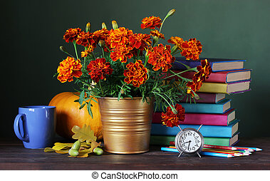 Back to school. first of September, knowledge day. Teacher's day. Still life with a bouquet, textbooks, autumn leaves and colored pencils.