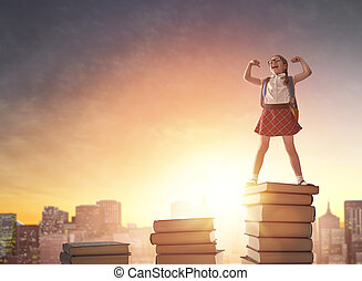 child standing on books - Back to school! Happy cute ...