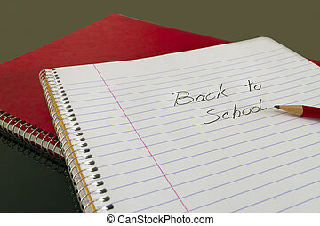 back to school in notebook with pencil