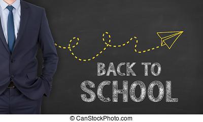 Back to school on blackboard background