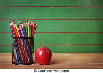 Back to school - Pencils and red apple on table