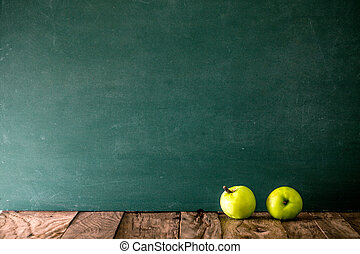 Back to school. School background with supplies. apple and...