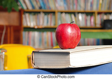 Back to school - Red apple on book