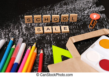 Back to School. School sale with trendy shadow on blackboard