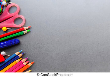 Back to school. School supplies on grey background for classes and lessons. Flat lay. Top view