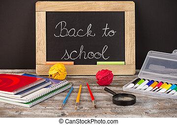 back to school, school supplies on wooden background