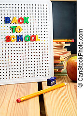 Back To School Sign - A letterboard on wooden planked table...