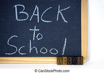 back to school sign on chalkboard