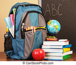 Back to school concept with books, apple and backpack