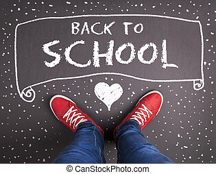 Back to school theme with hand drawn chalk sketched text on...