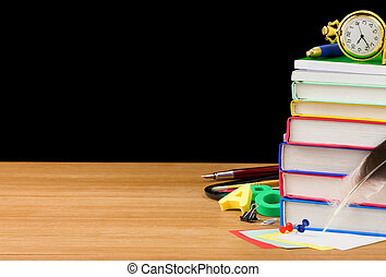 back to school supplies isolated on black background texture