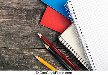 Back to School, supplies, notebook on the grey background