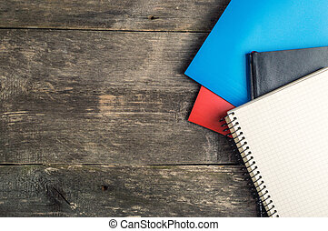 Back to School, supplies, notebook on the grey background, top view