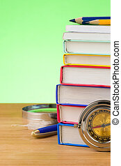 back to school supplies on green background