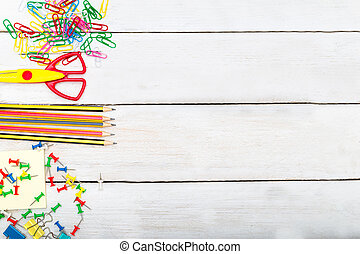 Back to school supplies on white wooden background