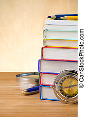 back to school supplies on wood background