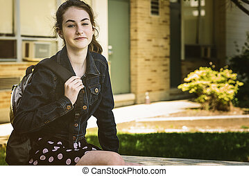 Back To School - Teen-aged female student heads back to ...
