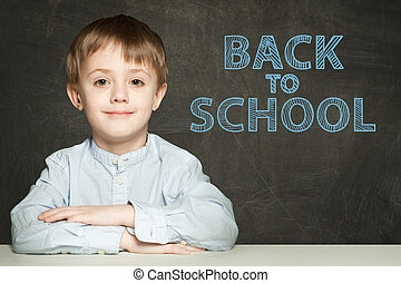 Back to school text and happy kid on chalkboard background
