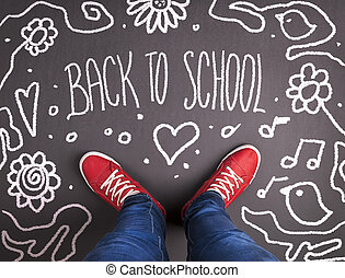 Back to school theme with hand drawn chalk sketched text on ...
