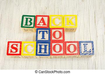 Back to school written in wooden cubicle letters