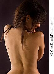 Back torso - Naked torso of woman\\\'s back body on dark...