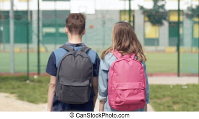 Back view children with bag - Back view - two schoolchildren...