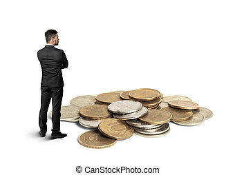 Back view cutout businessman standing in front of a copper heap ruble coins