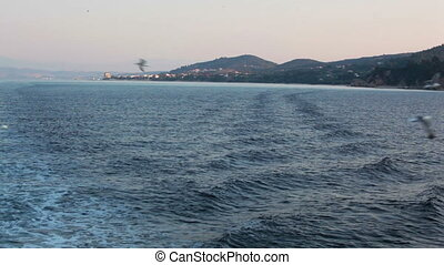 back view from pleasure boat at sea