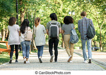 Back view image of multiethnic group of young students