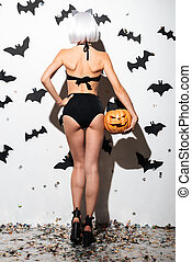 Back view image of pretty young woman in halloween costume...