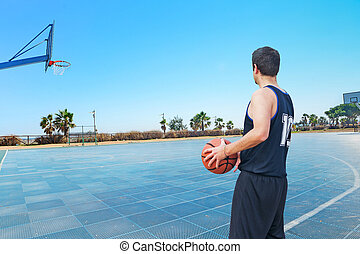 back view of a basketball player in a platground