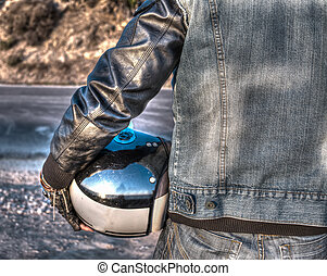 back view of a biker on the edge of the road at sunset in hdr