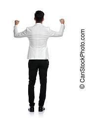 back view of a business man celebrating success