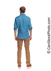 back view of a casual man standing