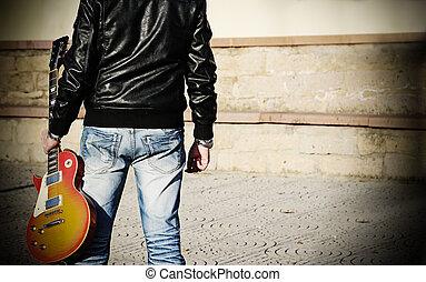 man holding a guitar
