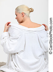 Back view of a woman disrobing