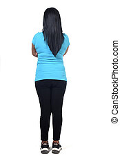 back view of a woman in white background, arms crossed