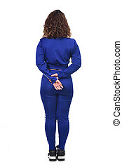 back view of a woman in white background, hands crossed