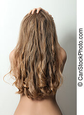 Back view of a woman with long blond hair