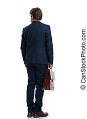 Back view of an old businessman holding his suit case