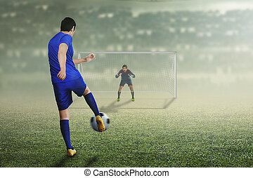 Back view of asian football player man in action