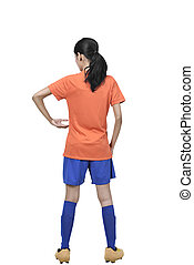 Back view of asian football player woman holding the ball