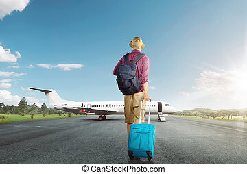 Back view of asian traveler man walking with suitcase to airplane