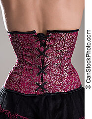 Back view of beautiful woman in purple corset